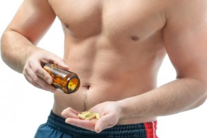 Athletic young man using bodybuilding dietary supplements. Sports nutrition